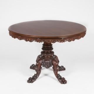CARVED MAHOGANY CENTRE TABLE