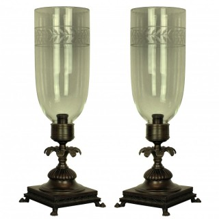 A PAIR OF REGENCY STYLE CANDLESTICKS WITH STORM SHADES