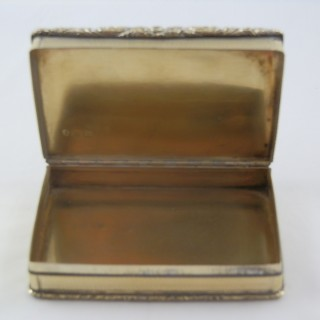 A George IV hunting scene silver gilt table snuff box,  Birmingham 1829