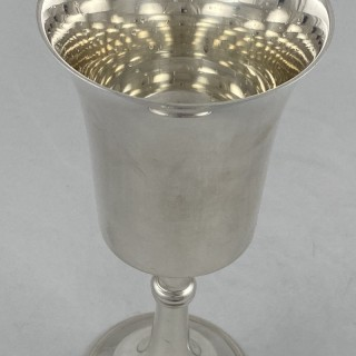 A Sterling Silver tall champagne or wine goblet made in 1970 by Roberts and Dore of Birmingham