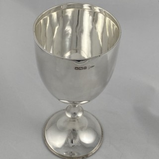 Antique Sterling silver plain goblet with a beaded pedestal foot 1910 Walker and Hall of Sheffield.