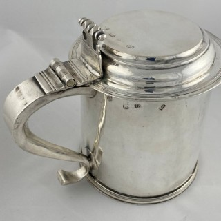 A Charles II Antique Sterling Silver lidded tankard made 1684 by Osmond Strickland of London