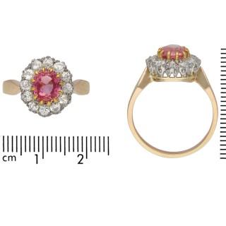 Padparadscha sapphire and diamond coronet cluster ring, circa 1910.