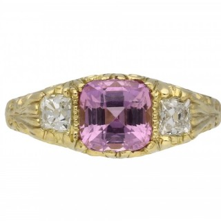 Victorian Ceylon pink sapphire and diamond three stone carved ring, English, circa 1900.