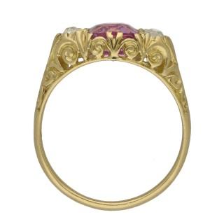 Victorian Ceylon pink sapphire and diamond three stone carved ring, English, circa 1900.