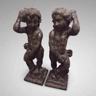 Pair of standing cherubs