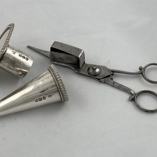 An Antique Sterling Silver George III chamberstick with steel wick trimmers.1817 John Mewburn of London.