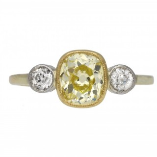Edwardian fancy yellow diamond three stone ring, circa 1915.