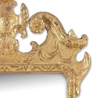An attractive late George I giltwood mirror