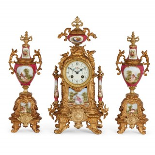 Gilt metal and painted porcelain clock garniture