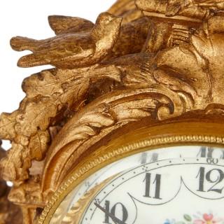 Gilt metal and painted porcelain clock garniture