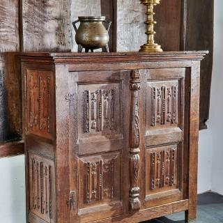 Henry VIII oak linenfold cupboard