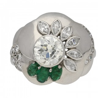 Vintage diamond and emerald flower ring by Seaman Schepps, American, circa 1965.