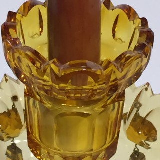 A pair of cut amber cut glass lustre candlesticks.