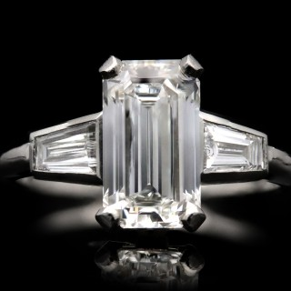 Vintage diamond flanked solitaire ring, circa 1950.