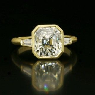 A beautiful 3.55ct vintage Asscher cut diamond rubover set in 18ct gold with a soft brushed finish.
