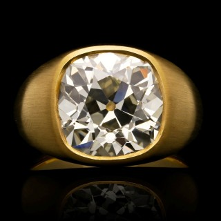 A stunning 7.90ct old mine brilliant cut diamond gypsy-set ring in satin finished 22ct gold.