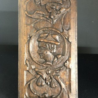 Carved oak portrait panel c1600