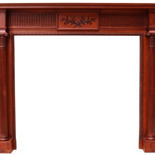 An Antique Carved Walnut Fireplace