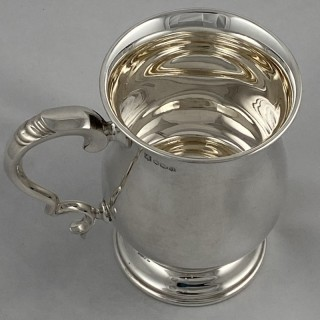 A Hallmarked sterling silver pint mug/ tankard 1962 Cooper Brothers and sons of Sheffield