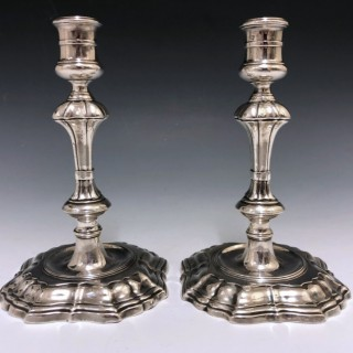 A pair of George II Antique Sterling Silver Cast Candlesticks made in 1738 by William Gould