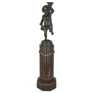 French bronze sculpture of a cherub raised on a column