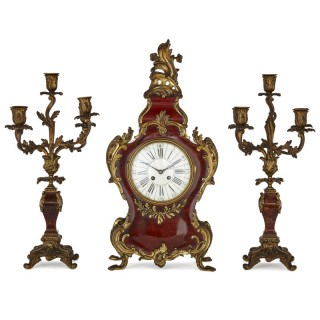 French three-piece tortoiseshell and gilt bronze clock set