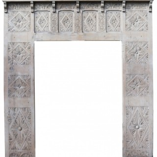 An Antique Carved Fireplace