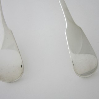 A pair of Antique George IV Sterling silver sauce ladles