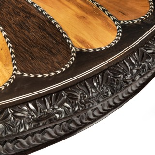 A large Anglo-Ceylonese ebony and specimen wood centre table circa 1840