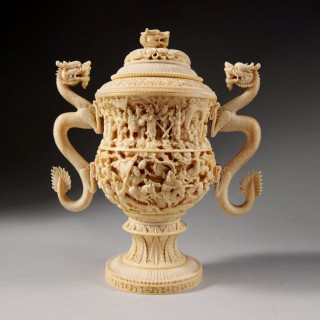 A carved ivory Koro cup and cover with dragon-handles and figures in relief, China, Qing Dynasty,