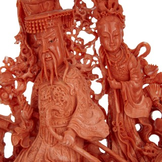 Large Chinese sculpted coral depicting a dignitary and attendants