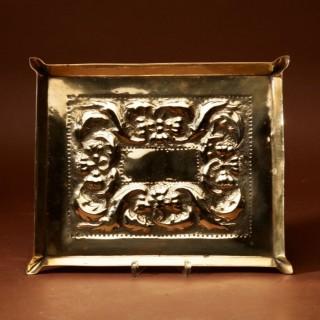 A Decorative Glasgow School Embossed Brass Tray.