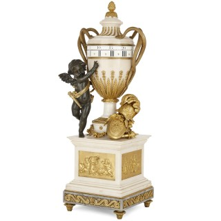 Large Neoclassical style marble and gilt bronze circular movement mantel clock