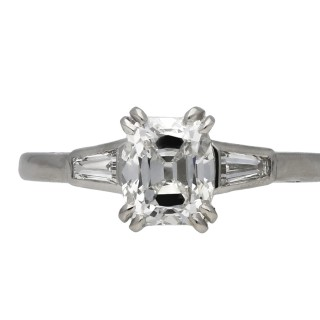 Art Deco old mine diamond flanked solitaire ring, circa 1920.