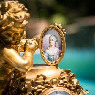 Louis XVI Style Gilt-Bronze and Sèvres Style Porcelain Mounted Figural Clock