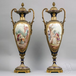 A Fine Pair of Gilt-Bronze Mounted Cobalt Blue Sèvres Style Porcelain Vases and Covers