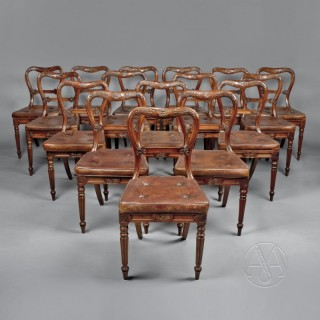 A Set of Eighteen Red Walnut Dining Chairs