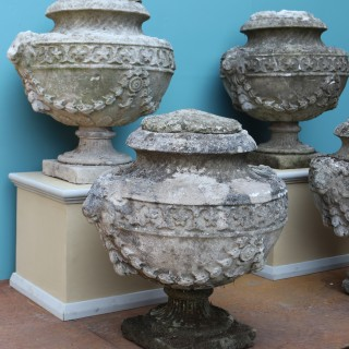 A Set of Four Reclaimed Georgian Style Lidded Stone Urn Finials