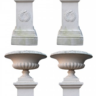 A Set of Four Large Terracotta Garden Urns with Pedestals