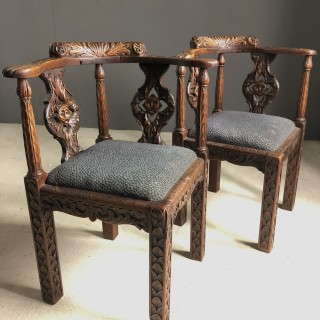 Well Carved Corner Chairs with Moon Face Rounders Circa 1830