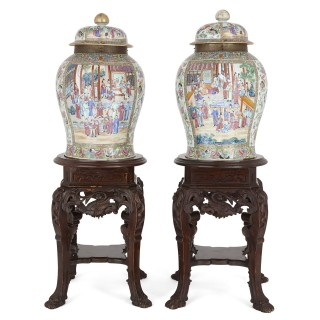 Pair of Chinese Canton porcelain vases on carved wooden pedestals