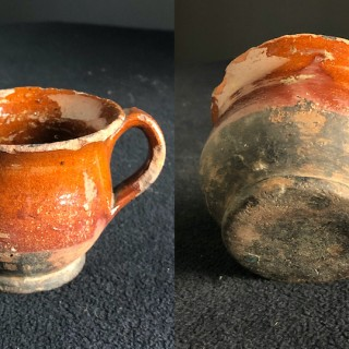 16th Century glazed cup with handle many chips