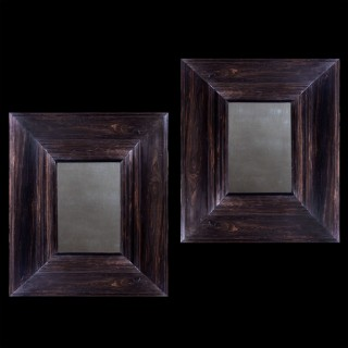 Impressive pair of solid ebony Indo Dutch Wall Mirrors