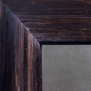 Impressive pair of solid ebony Indo Dutch Wall Mirrors