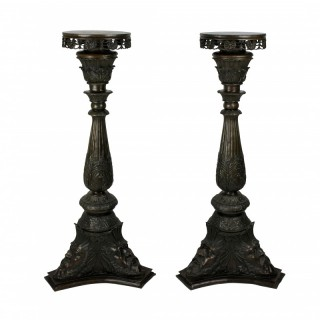 A PAIR OF VENETIAN BRONZE TORCHERE PEDESTALS