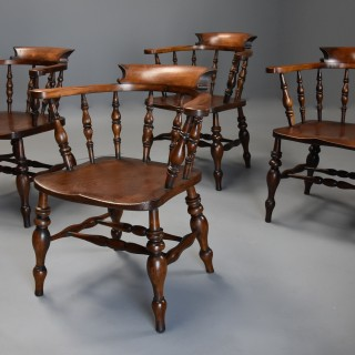 Set of four mid 19th century beech and elm smokers bow Windsor or Captains chairs of large proportion, with makers stamp 'GJH'.