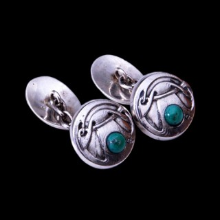 A pair of Archibald Knox silver turquoise cufflinks for Liberty & Co
