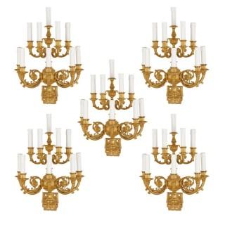 Set of five Neoclassical gilt bronze wall lights