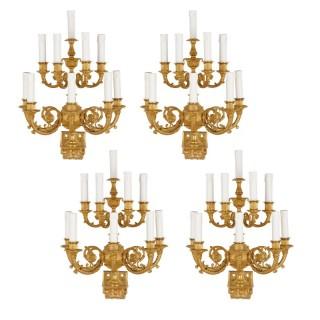 Set of four Empire style ten-branch gilt bronze sconces
